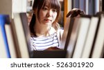 woman studying in the library | Shutterstock . vector #526301920