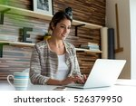 young woman working at her... | Shutterstock . vector #526379950