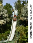 Small photo of Busch Gardens, Tampa, Florida, USA - October 27, 2016: Tourists on Stanley Falls log flume in Busch Gardens Tampa