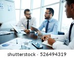 discussing financial data | Shutterstock . vector #526494319