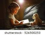 child girl reading a book in... | Shutterstock . vector #526500253