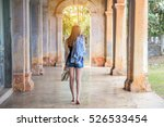 back of beautiful woman holding ... | Shutterstock . vector #526533454