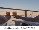 Couple On Vacation Deck With...