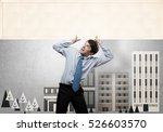 emotional businessman lifting... | Shutterstock . vector #526603570
