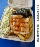 Small photo of Mauka - Makai: BBQ Kalbi AND Ono with coleslaw and french fries on a biodegradable Container plate.