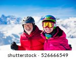 Happy Mature Couple Skiing In...