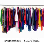 Stock photo variety of casual female clothes of different colors on hangers 526714003