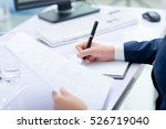 businesswoman working at desk... | Shutterstock . vector #526719040