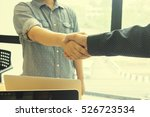 Small photo of Great job,Sealing a good deal,Successful,Handshake of two business people standing at the working place,for collaborative cooperation and participation,Vintage tone,copy space