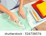closeup of woman ironing... | Shutterstock . vector #526738576