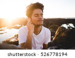 young guy listening to music on ... | Shutterstock . vector #526778194