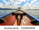 male's feet relaxing on a boat.   Shutterstock . vector #526803838