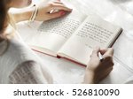 young woman writing diary... | Shutterstock . vector #526810090