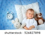 one year old baby lying in bed... | Shutterstock . vector #526827898
