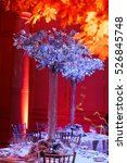 Small photo of Silver bouquets beautify dinner tables prepared for wedding party