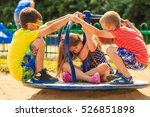 Small photo of Joyful active childhood. Playful kids playing on playground. Children having fun in summer. Young tourists spending actively time.