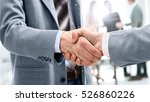 closeup of a business handshake | Shutterstock . vector #526860226