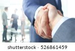 closeup of a business handshake | Shutterstock . vector #526861459