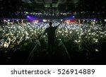 Small photo of MOSCOW-3 NOVEMBER,2016:Popular rap singer on stage.Pop music concert in nightclub.Musician on scene,view from stage on festival audience in music hall.View from stage on group of fans with smartphones