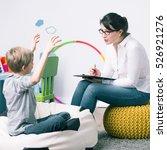 boy and young woman teacher... | Shutterstock . vector #526921276
