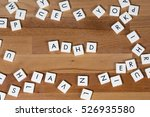 adhd text on a wooden surface.... | Shutterstock . vector #526935580