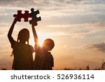 silhouette of two happy... | Shutterstock . vector #526936114
