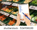 woman with notebook in store ... | Shutterstock . vector #526938100
