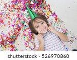 young boy blows out confetti ... | Shutterstock . vector #526970860