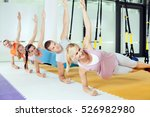 group of people performing trx... | Shutterstock . vector #526982980