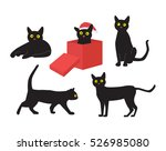 Stock vector black cats with one sitting in a red box wearing santa hat 526985080