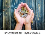 Top View Many Coins In Hands O...