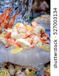 Small photo of Cooked Alaska King Crab Legs on ice