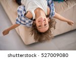 cute kid at home upside down...   Shutterstock . vector #527009080
