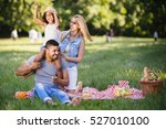 happy family enjoying picnic in ... | Shutterstock . vector #527010100