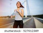 Happy Sporty Woman Jogging...