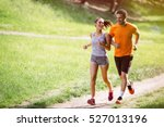 Couple Jogging And Running...