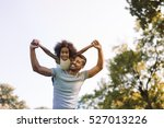 father carrying daughter on... | Shutterstock . vector #527013226