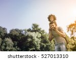 father carrying daughter on... | Shutterstock . vector #527013310