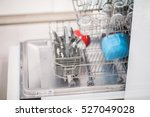 open dishwasher with clean... | Shutterstock . vector #527049028