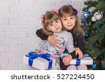 two sisters with gifts sitting... | Shutterstock . vector #527224450