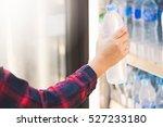 woman choosing cold  bottle of... | Shutterstock . vector #527233180