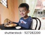 Cute Little Boy Eating Breakfast
