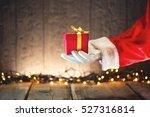 Santa Claus Hand Holding...