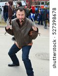 Small photo of Calgary, Alberta, Canada, April 25 2014: Wolverine from the X-men cosplay posing outside the Comic and Entertainment Expo at Calgary, Alberta