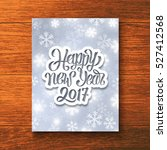 happy new year 2017 hand... | Shutterstock .eps vector #527412568