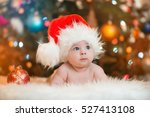 Little Baby In Red Cap Of Sant...