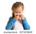 Cute little girl blowing nose...