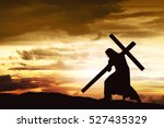 Silhouette Of Jesus Carry His...