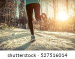 woman running at snowly winter... | Shutterstock . vector #527516014