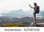 young lady hiker with backpack... | Shutterstock . vector #527587234